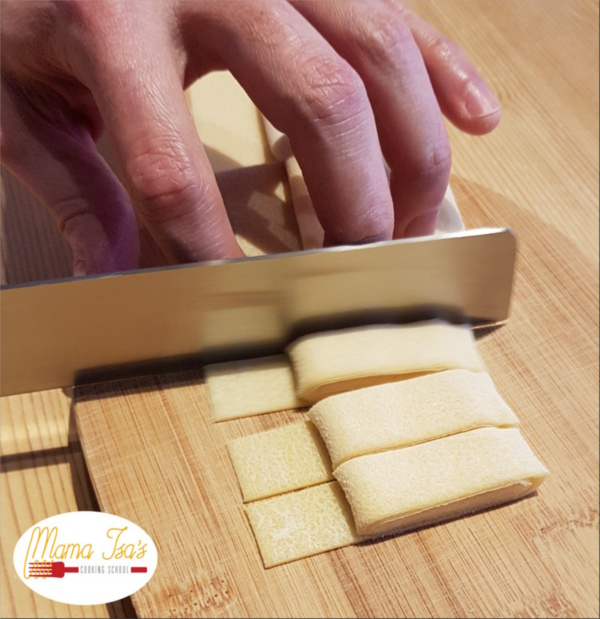Cutting Pasta by hand in Italy at Mama Isa's Cooking School